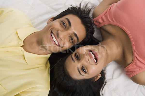 Casal cama sorridente amor masculino Foto stock © imagedb