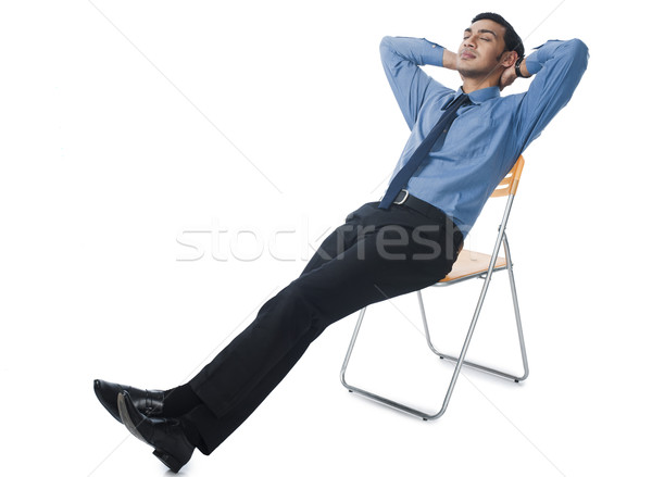 Bengali businessman reclining on a chair Stock photo © imagedb