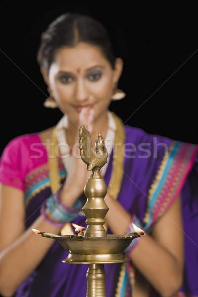 Közelkép nő imádkozik szépség fiatal láng Stock fotó © imagedb