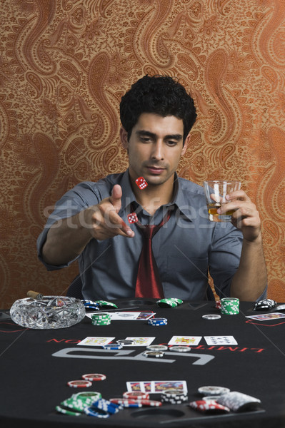 Férfi kaszinó asztal piros siker kocka Stock fotó © imagedb