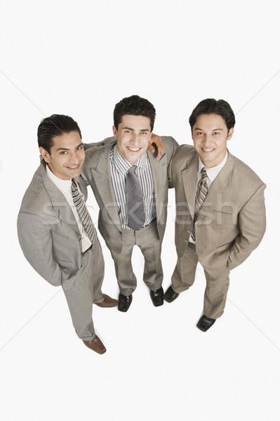 Portré három üzletemberek mosolyog üzlet üzletember Stock fotó © imagedb