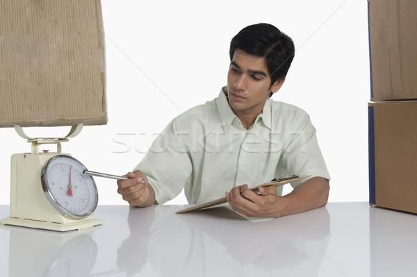 Depolamak paket ağırlık ölçek ofis adam Stok fotoğraf © imagedb
