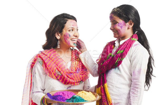 Woman celebrating Holi festival with her daughter Stock photo © imagedb