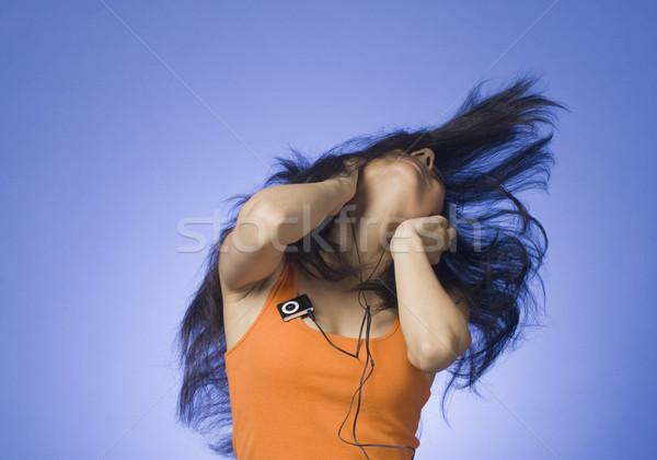 прослушивании mp3-плеер синий женщину музыку Сток-фото © imagedb