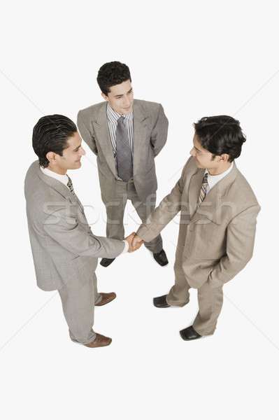 два бизнесменов рукопожатием другой бизнесмен Постоянный Сток-фото © imagedb