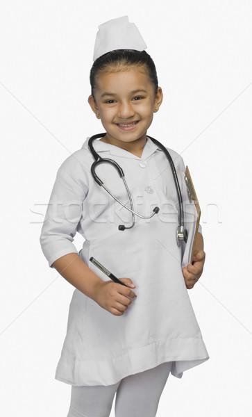 девушки медсестры улыбаясь ребенка портрет платье Сток-фото © imagedb