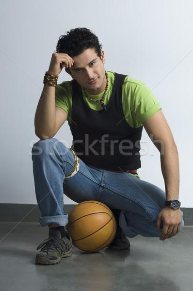 Portré férfi ül kosárlabda divat farmer Stock fotó © imagedb