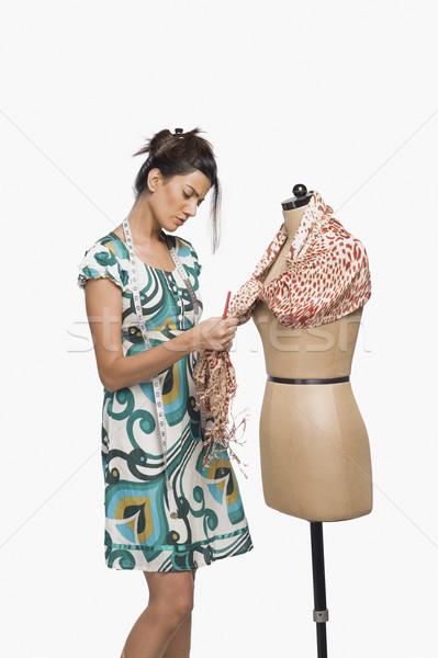 Vrouwelijke mode ontwerper jurk etalagepop permanente Stockfoto © imagedb