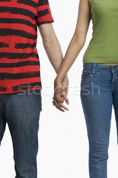 Ver casal de mãos dadas amor jeans Foto stock © imagedb