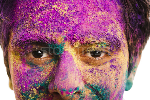 Mans face covered with powder paint during Holi festival Stock photo © imagedb