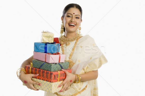 портрет женщину традиционный подарки улыбаясь Сток-фото © imagedb