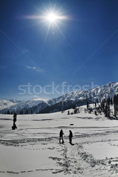 Tourists skiing on the snow covered landscape, Kashmir, Jammu An Stock photo © imagedb
