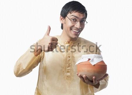 Bengali man pointing towards a pot of rasgulla Stock photo © imagedb