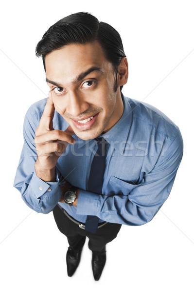 Bengali businessman thinking and smiling Stock photo © imagedb