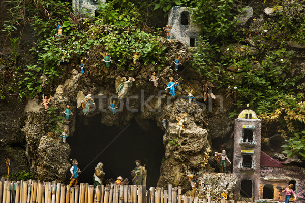 Cave and miniature houses on the rocks Stock photo © imagedb