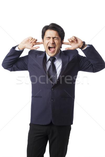Empresario gritando dedos orejas hombre jóvenes Foto stock © imagedb