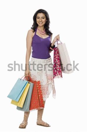 женщину торговых молодые улыбаясь Сток-фото © imagedb