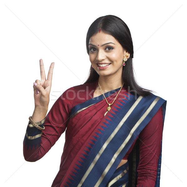 Stock photo: Traditionally Indian woman gesturing victory sign