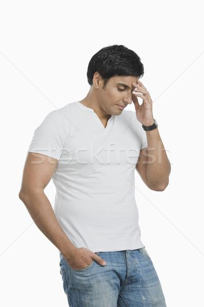 Man thinking and looking serious Stock photo © imagedb