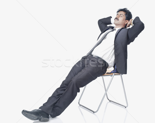 South Indian businessman resting on a chair Stock photo © imagedb
