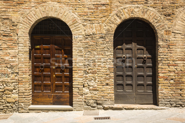 Closed doors of a building in the medieval town of San Gimignano Stock photo © imagedb