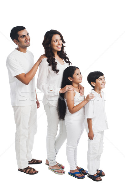 Happy family lined up shortest to tallest Stock photo © imagedb