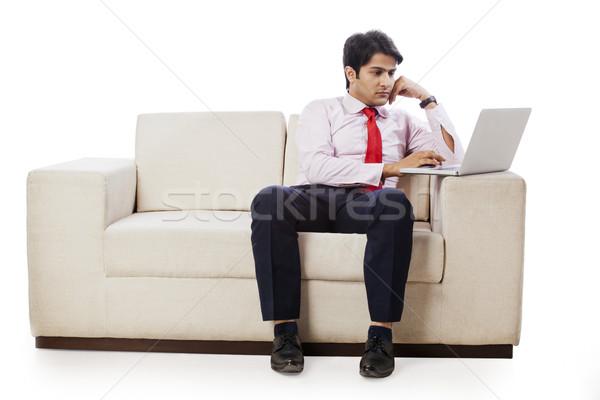 бизнесмен сидят диване рабочих ноутбука человека Сток-фото © imagedb