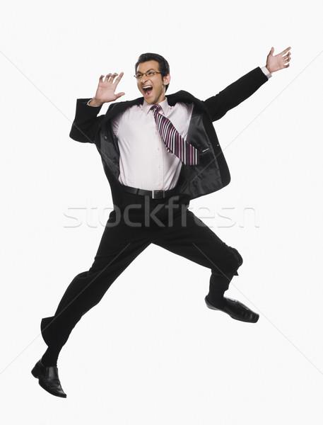 Işadamı atlama iş adam siyah başarı Stok fotoğraf © imagedb