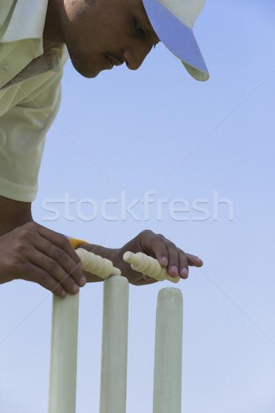 Cricket giocatore uomo piedi cap giocare Foto d'archivio © imagedb