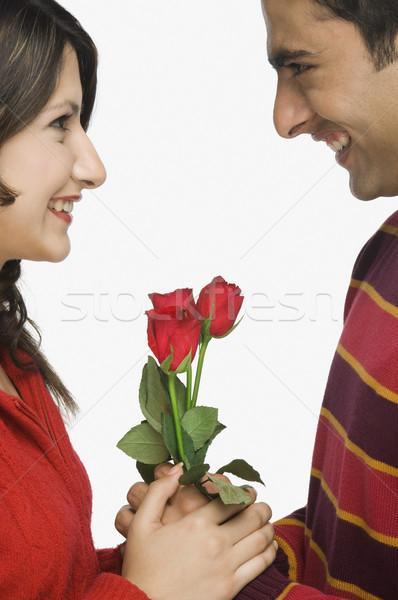 Közelkép pár nő virág szeretet férfi Stock fotó © imagedb