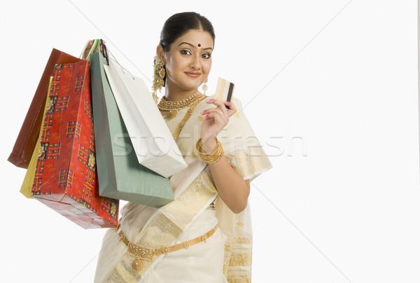 Portré nő tart bevásárlótáskák hitelkártya mosolyog Stock fotó © imagedb