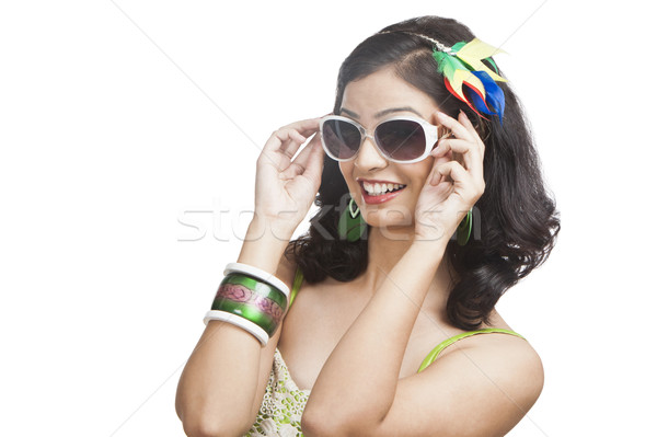 Beautiful young woman posing with sunglasses Stock photo © imagedb