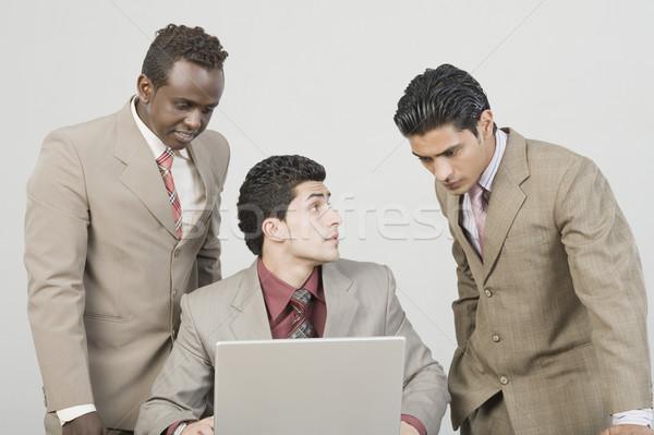 Három üzletemberek dolgozik laptop üzlet üzletember Stock fotó © imagedb