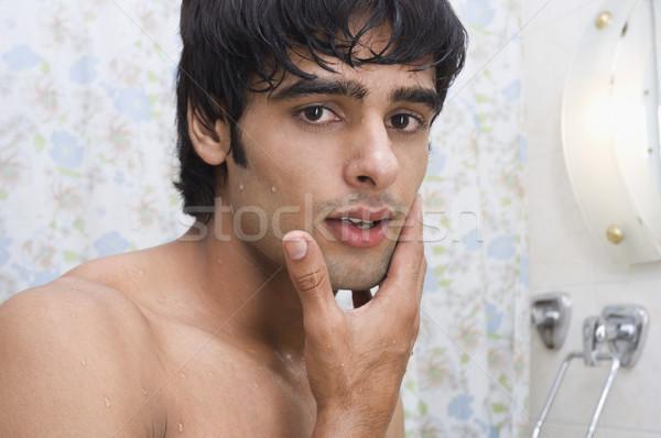 Retrato homem tocante cara barbear casa Foto stock © imagedb
