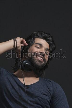 человека прослушивании наушники улыбаясь развлечения 20-х годов Сток-фото © imagedb