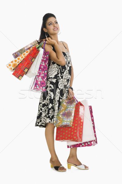 Kadın genç düşünme alışveriş çantası Stok fotoğraf © imagedb