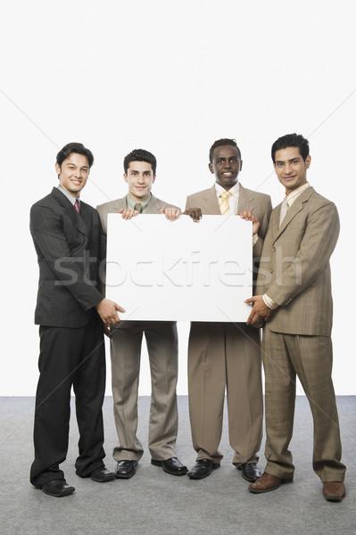 Portré négy üzletemberek mutat üzlet üzletember Stock fotó © imagedb