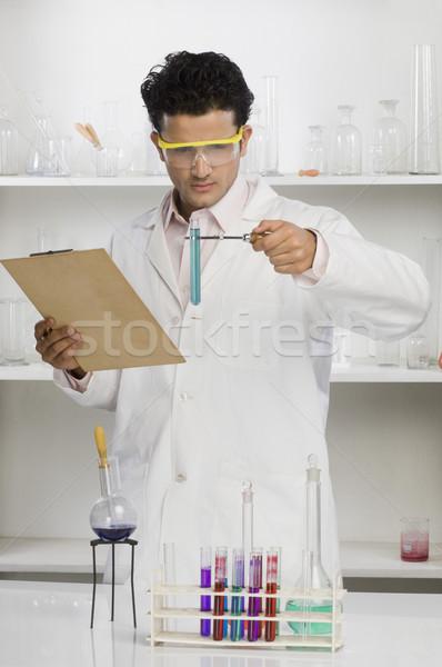 Wetenschapper chemische concentratie zwart haar Stockfoto © imagedb
