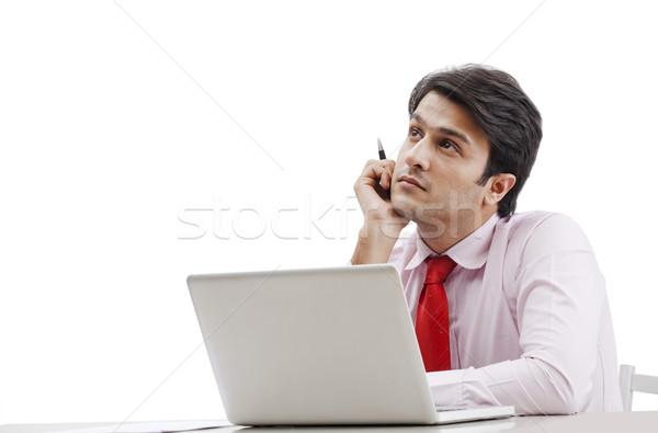 бизнесмен мышления ноутбука бумаги человека пер Сток-фото © imagedb