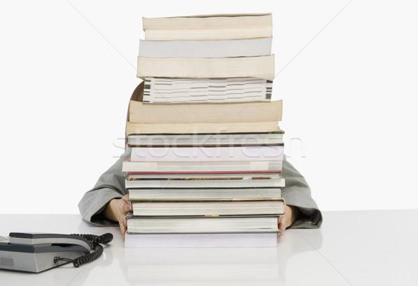 üzletember rejtőzködik mögött boglya könyvek könyv Stock fotó © imagedb