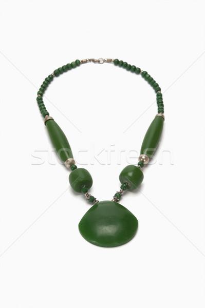 Közelkép nyaklánc zöld modern luxus fehér háttér Stock fotó © imagedb