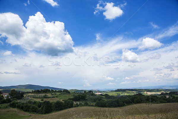 Clouds over a landscape Stock photo © imagedb