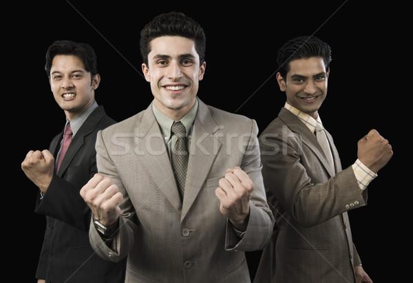 Portré három üzletemberek éljenez férfiak mosolyog Stock fotó © imagedb