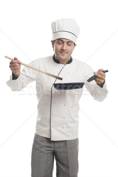 Male chef preparing food in a frying pan and  smelling Stock photo © imagedb