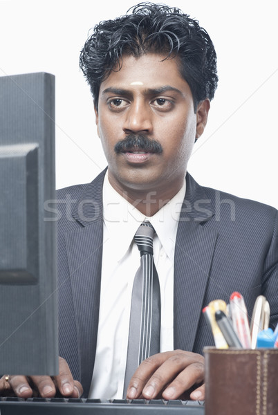 South Indian businessman working on a computer Stock photo © imagedb