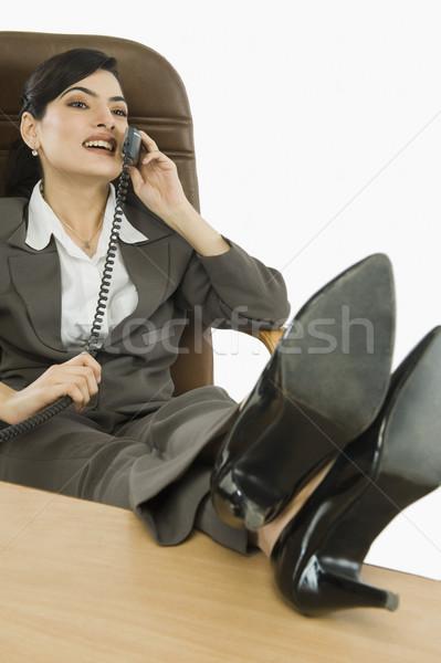 üzletasszony beszél telefon iroda asztal kommunikáció Stock fotó © imagedb