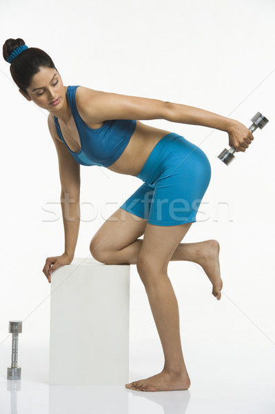 женщину гантели спорт фитнес синий Сток-фото © imagedb