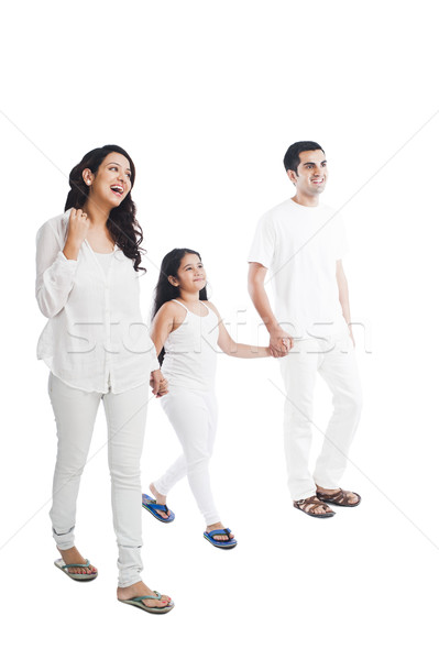 Stock photo: Happy parents with their daughter holding hands