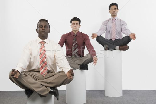 Három üzletemberek gyakorol jóga üzlet testmozgás Stock fotó © imagedb