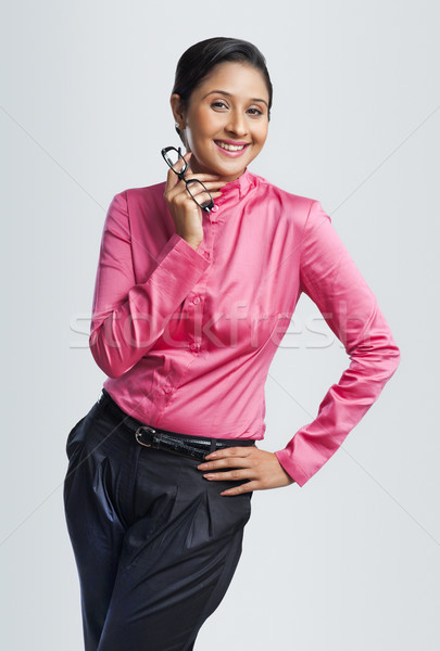 Portrait of a businesswoman smiling with her hand on hip Stock photo © imagedb